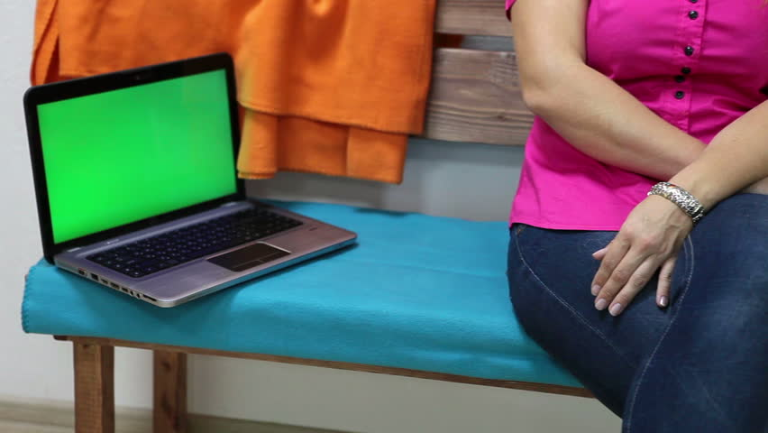 Green screen laying on bench and woman resting near after working