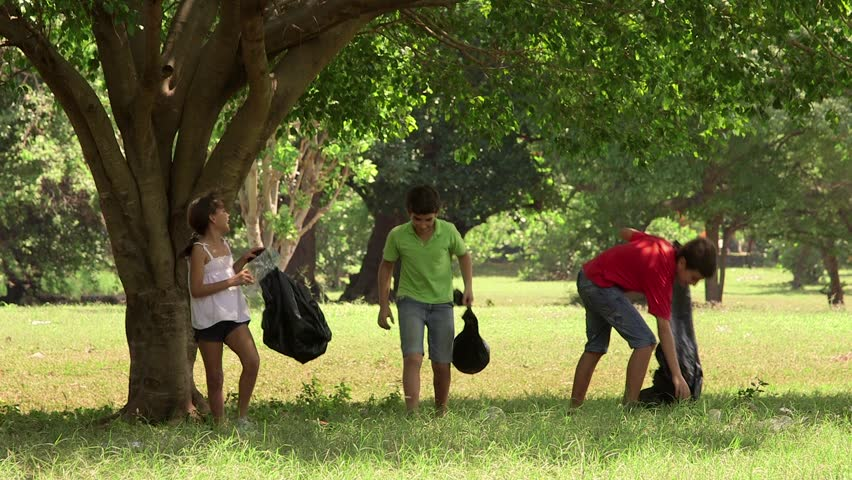 Ecology, children, young people, future and environment, portrait of latin american girl and boys cleaning a park from trash, rubbish, garbage. 14of18 - HD stock footage clip