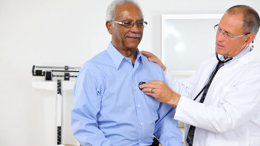 Doctor listening to a patient's heartbeat.