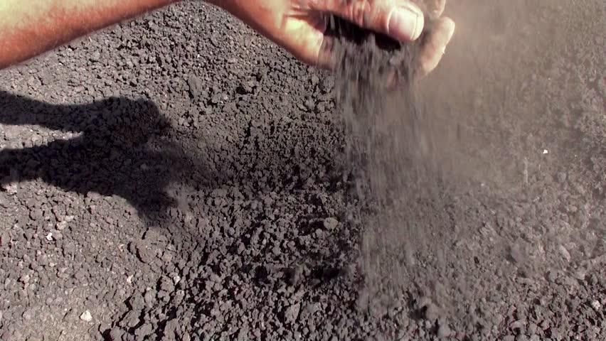 Slag Sand And Gravel : Fx solid stream of gravel dumping against black background