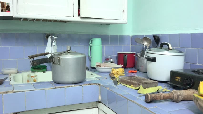 `SANTA CLARA,CUBA-AUGUST 14, 2014: Inside a  middle class typical Cuban kitchen. After more than 50 years of Revolution most of the population is impoverish and with minimal means.