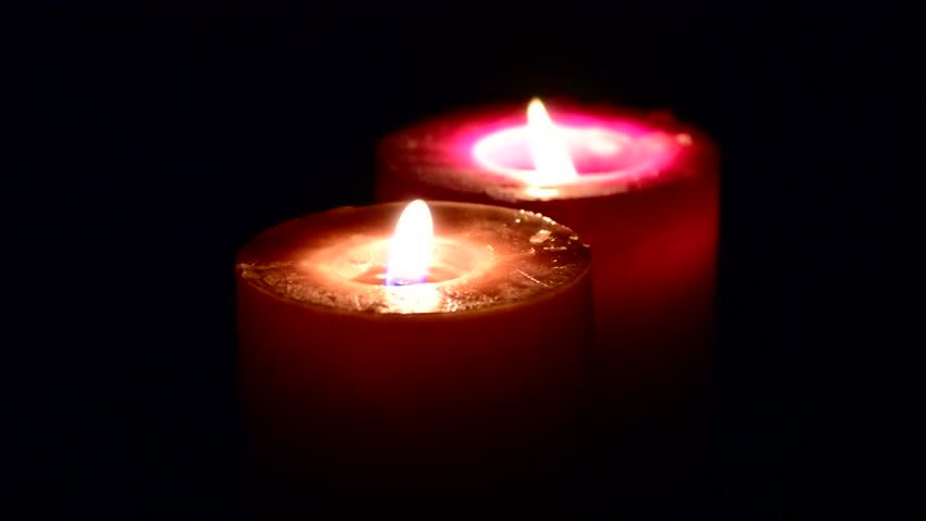 Two Candles Burning in the Darkness
