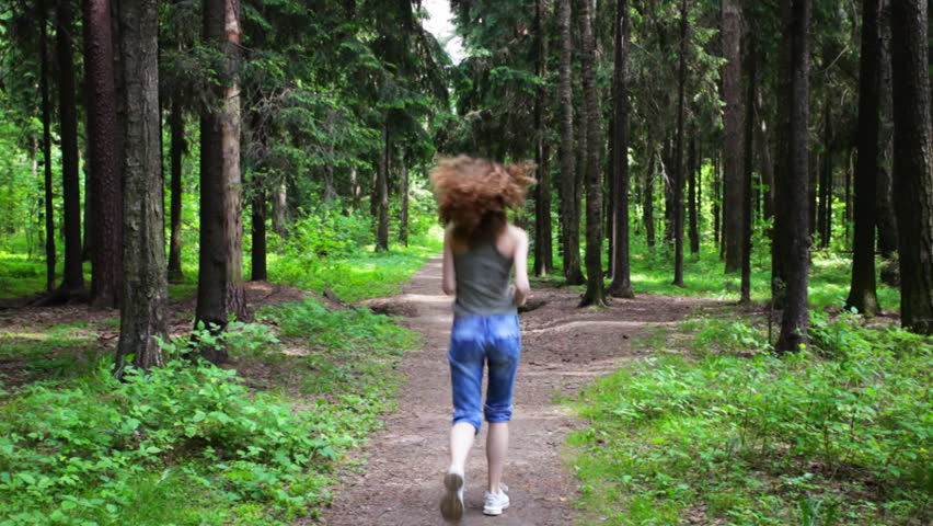 Woman jogging in a summer forest - HD stock footage clip