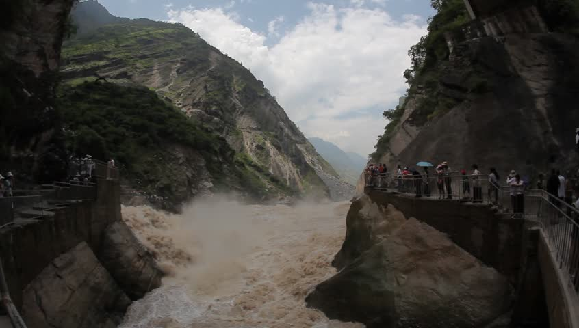 YUNAN, CHINA - AUGUST 30: In the peak of the season, Chinese and world travelers enjoy hiking and watching Tiger Leaping Gorge in Yunnan, August 30, 2009