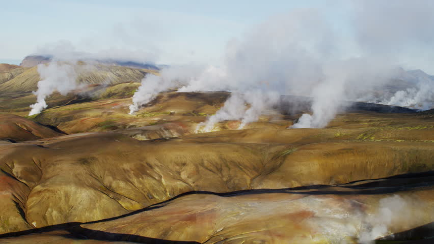 Aerial mountain view mineral colours steam venting volcanic active area thermal energy Landmannalaugar Wilderness travel Iceland RED EPIC - 4K stock video clip