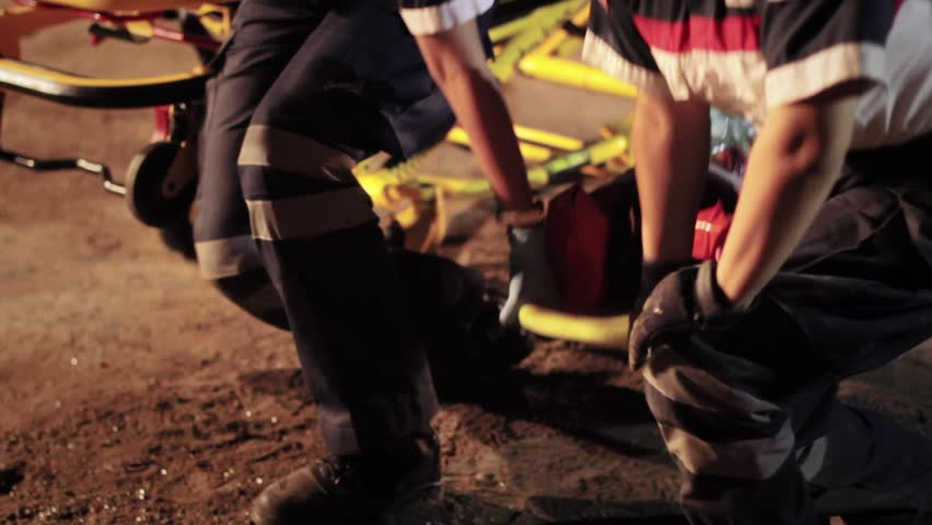 Paramedics helps an injured woman moving the stretcher from accident place - HD stock video clip