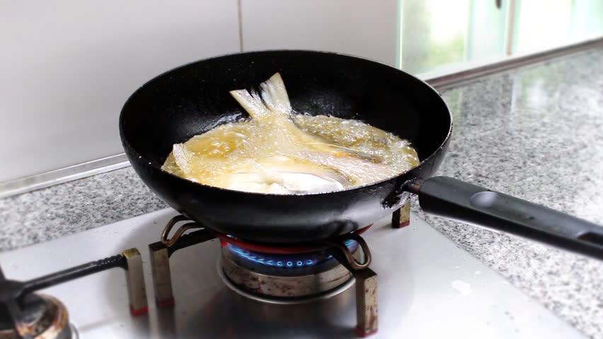 Fresh fish frying in hot oil stock footage video 7759702 for Oil for frying fish