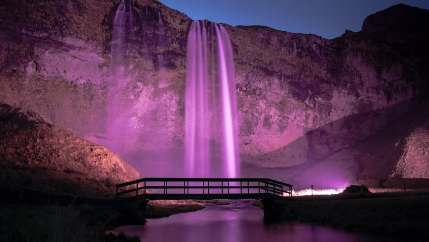Seljalandfoss waterfall in south Iceland, at night. Timelapse footage.