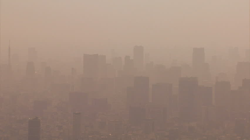 Aerial Metropolis environmental view city air pollution weather from mainland China over central Tokyo Japan Asia