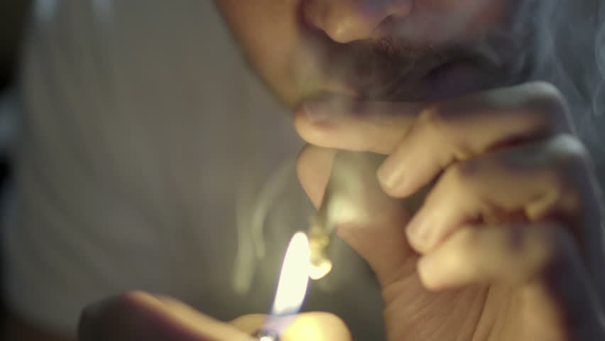 Man Smoking Marijuana - Guy Takes Pull from Weed Blunt and Exhales Smoke in Slow Motion