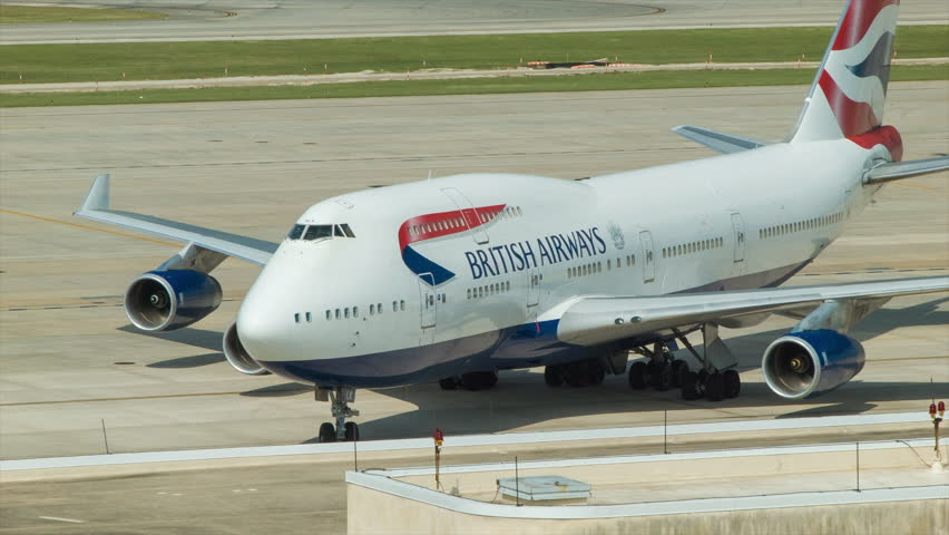 HOUSTON TX - 2014: British Airways Boeing 747 Approaching a International Terminal D Gate at George Bush Intercontinental Airport in Houston TX on a Hot and Sunny Texas Day