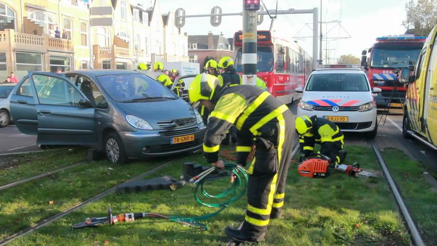 THE HAGUE, HOLLAND - NOVEMBER 2: Tram has collided with a car in The Hague, Holland on november 2, 2014. Police, fire brigade and ambulance were there but no one was hurt.
