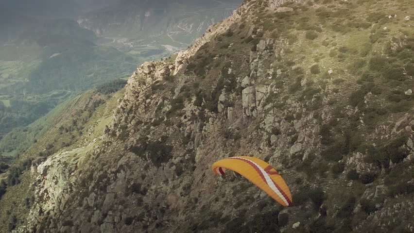 Stunning aerial shot of paragliders flying over a spectacular mountain view. Pyrenees, Spain. HD