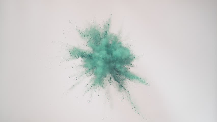 Colorful powder/particles fly after being exploded against black background. Shot with high speed camera, phantom flex 4K. 4K 30fps. Slow Motion. Unedited version is included at the end of clip.
