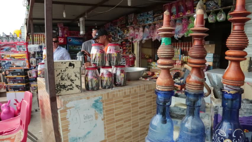 Basra, Iraq, October 2014: Iraqi Customers Browse Through the Goods at an Outdoor Market in Basra, Iraq, October 2014.