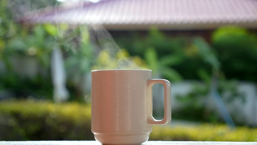 Cup of Hot Coffee with Steam Outdoors. Slow Motion. HD, 1920x1080. - HD stock footage clip