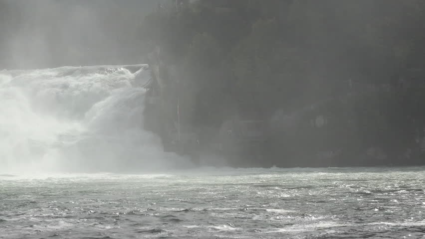 SCHAFFHAUSEN, SWITERLAND - SEPT 2014: Switzerland Rhine Falls beautiful natural waterfall pan. Largest natural river waterfall in Europe. Tourist boats take passengers into the mist. Spectacular view. - 4K stock footage clip