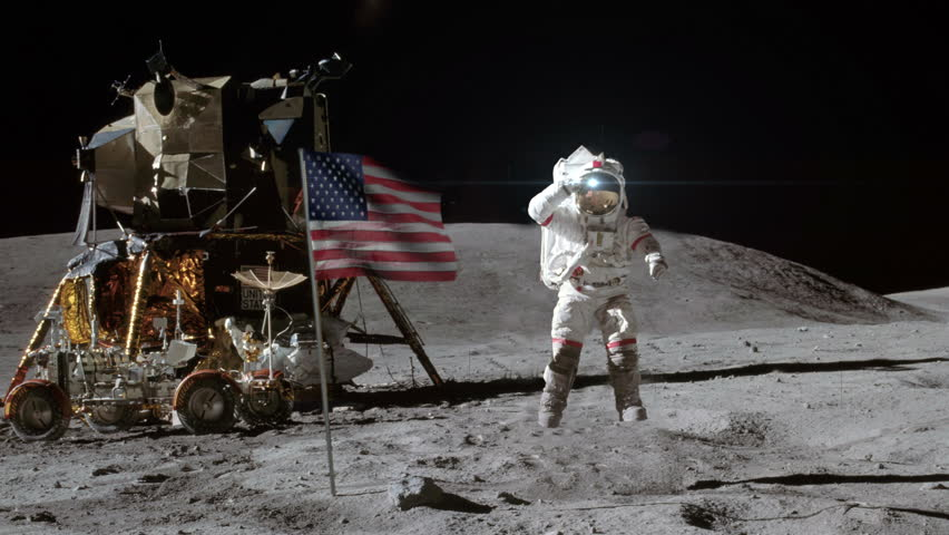 Astronaut on the moon with flag - 4K stock footage clip