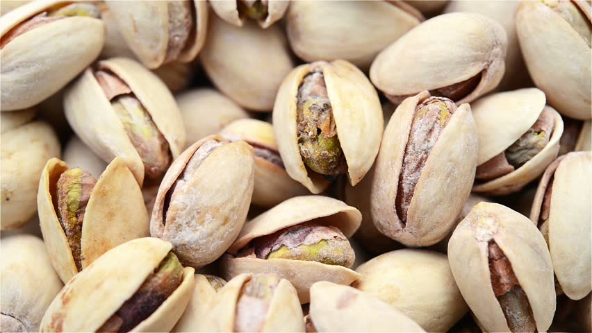 roasted salted appetizing pistachios rotating