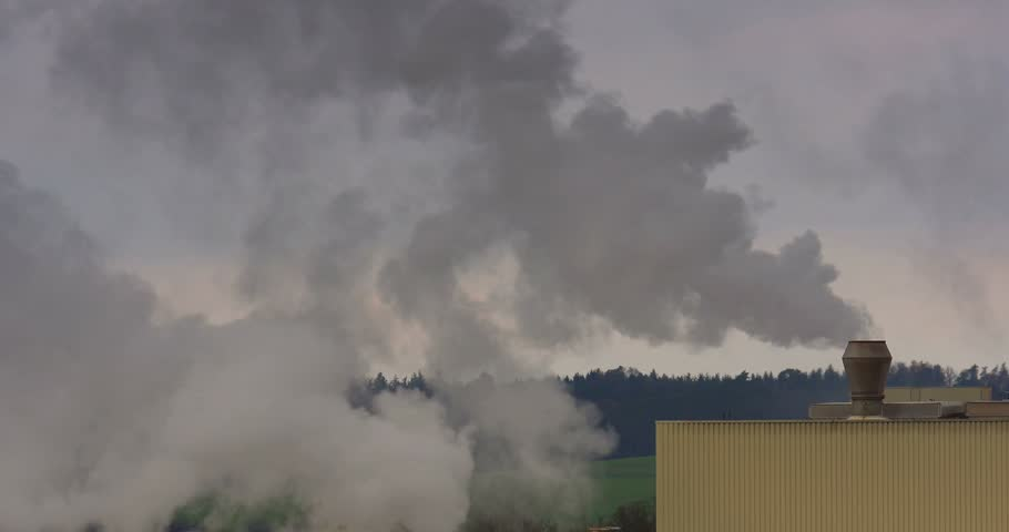 Chemical factory with smoke stack, air pollution - 4K stock footage clip