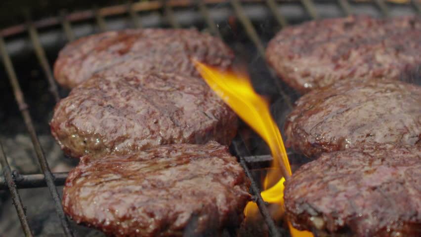 Grilling hamburgers, slow motion
