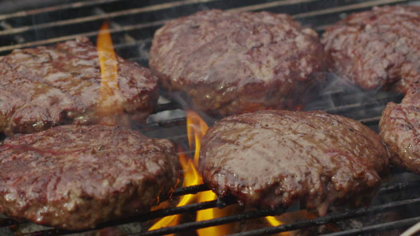 Grilling hamburgers, slow motion