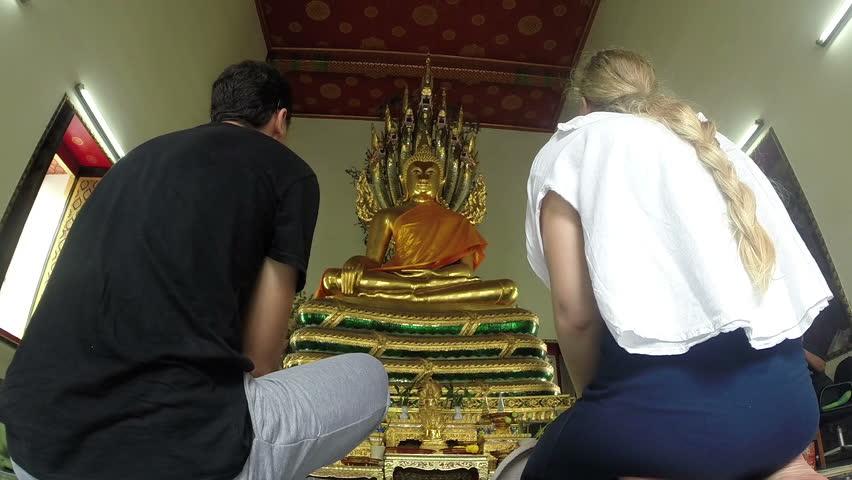 Tourists visit Buddhist Temple.Thailand