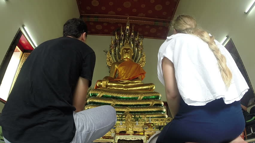 Tourists visit Buddhist Temple.Thailand