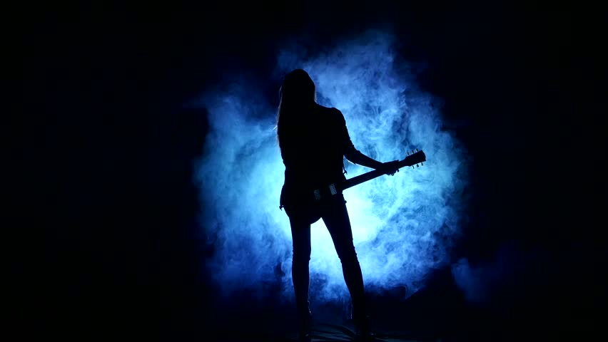 Silhouette Of A Young Girl Dancing With Electric Guitar On ...