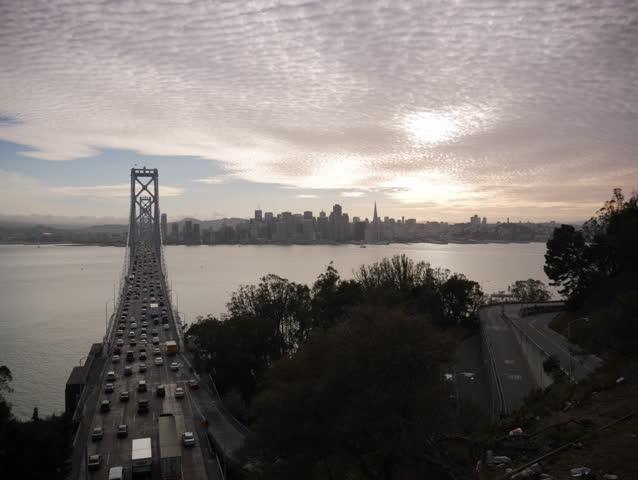 Treasure Island, California - October, 2014 - Timelapse of the San Francisco Bay Bridge and skyline at sunset.