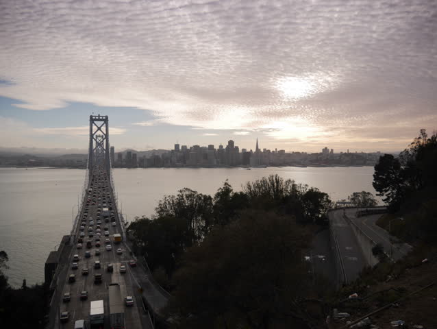 Treasure Island, California - October, 2014 - Timelapse of the San Francisco Bay Bridge and skyline at sunset.