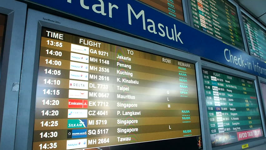 KUALA LUMPUR, MALAYSIA -NOVEMBER 15, 2014 Flight notice board in the departures terminal of KLIA. KLIA is Malaysia's main international airport and one of the major airports of South East Asia.