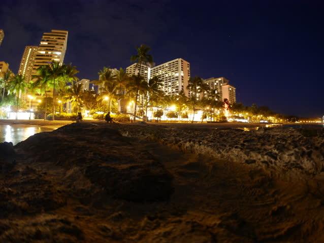 Honolulu, Hawaii - June, 2014 - Panning timelapse of Waikiki Beach at night.