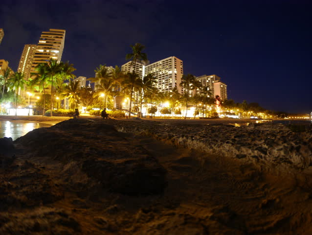 Honolulu, Hawaii - June, 2014 - Panning timelapse of Waikiki Beach at night.