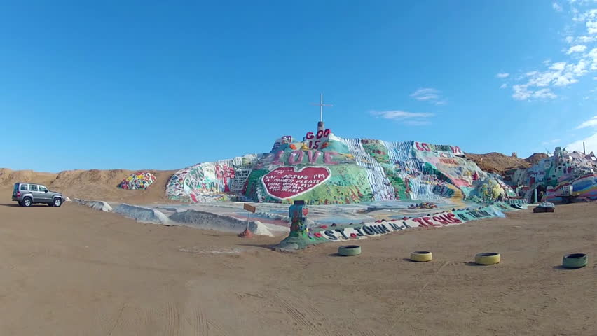 NILAND, CA: December 4, 2014- Shot of God is Love hill at Salvation Mountain circa 2014 in Niland. A very colorful painted man made structure of enormous size broadcasts a simple religious message.