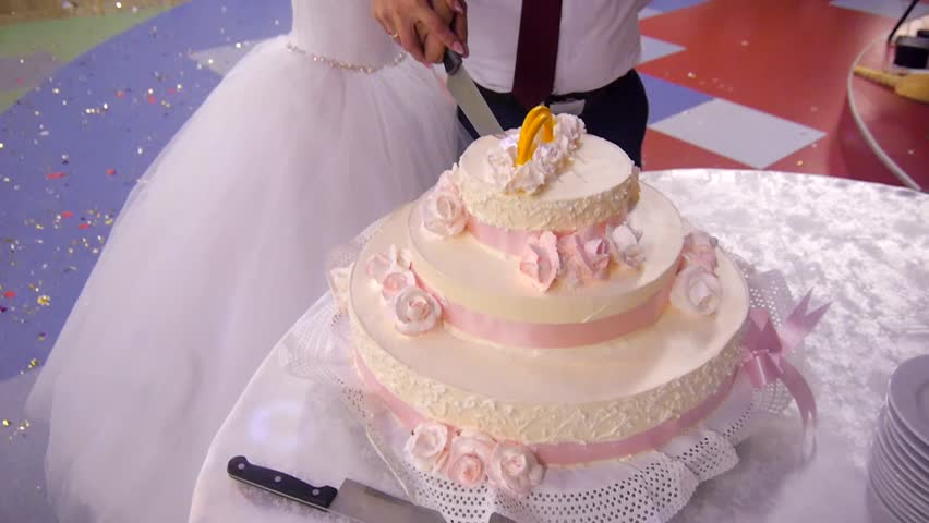 the couple cut the wedding cake