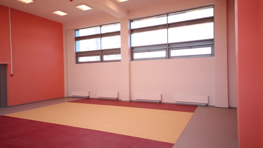 Empty playroom with pink walls and window in new play school