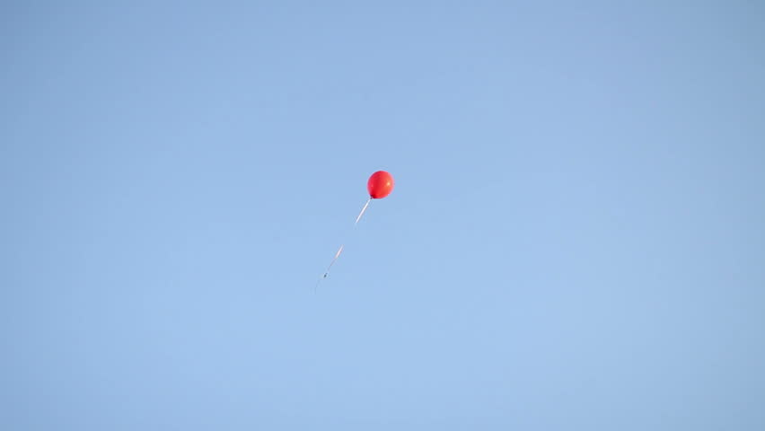 red balloon in the sky at burthday party