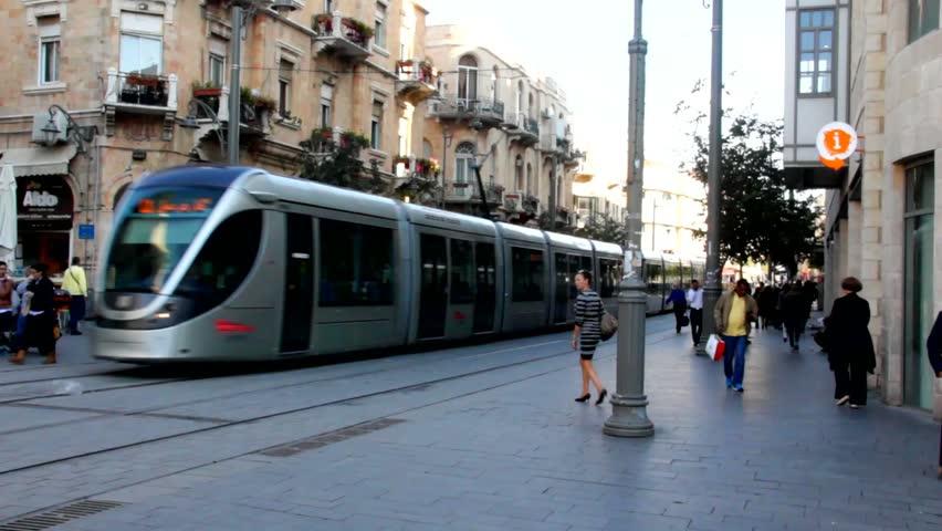 JERUSALEM, ISRAEL - NOVEMBER 18: New tram and Visitors at Ben Yehuda Street at ordinary evening on November 18, 2014 in Jerusalem, Israel. , It's a major and famous pedestrian mallstreet