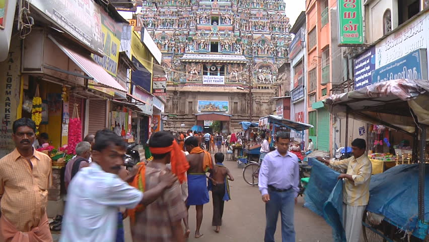 MADURAI - CIRCA 2014: Wide Shot of street with crowds of people at West Tower, Meenakshi Amman Temple circa 2014 in Madurai, Tamil Nadu, India. - HD stock footage clip