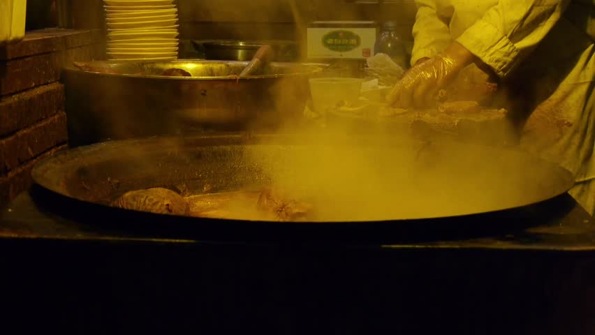 china tradition gourmet,pot roast in cauldron,chef cutting cooked meat. gh2_05971 - HD stock footage clip