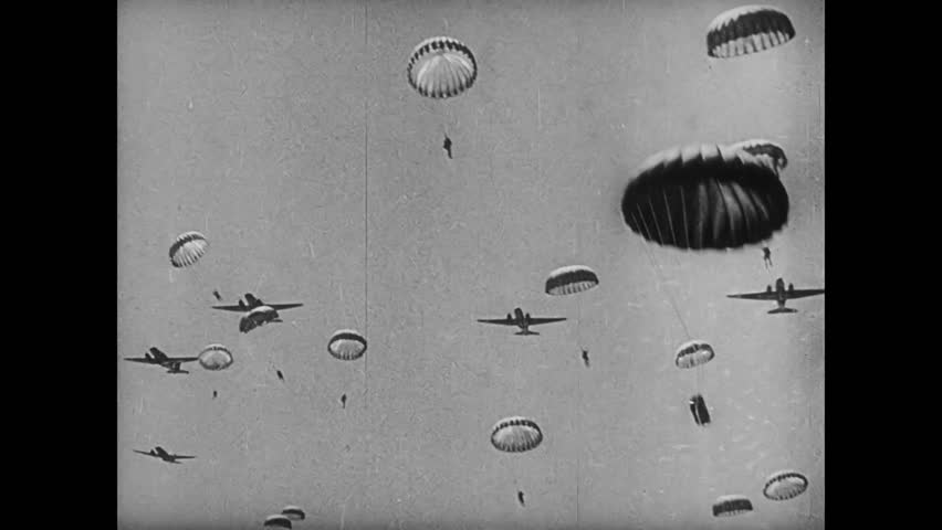 Paratroopers jumping from plane, 1940s - HD stock footage clip