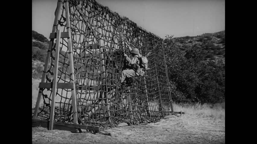 Soldier caught in rope ladder during basic training, 1940s