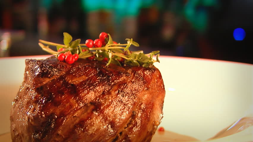 meat rotating on a dinner plate - HD stock footage clip