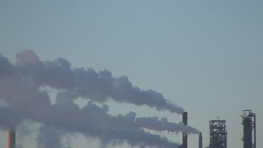 ROMANIA. BRASOV, 11 JANUARY, 2014: Industry energy, environment pollution cause. Air pollution by chemical smoke.  - HD stock footage clip