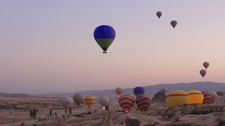 "CAPPADOCIA, TURKEY - August 30 2014:""the Hot air balloon flying over rock landscape at Cappadocia Turkey""  On August 30, 2014 in Cappadocia, Turkey."