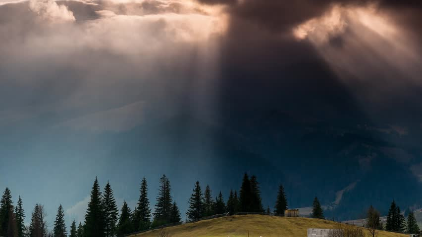 Time lapse clip. Fantastic mountain landscape with sun rays . Carpathian, Ukraine, Europe. Beauty world. Full HD video (High Definition)