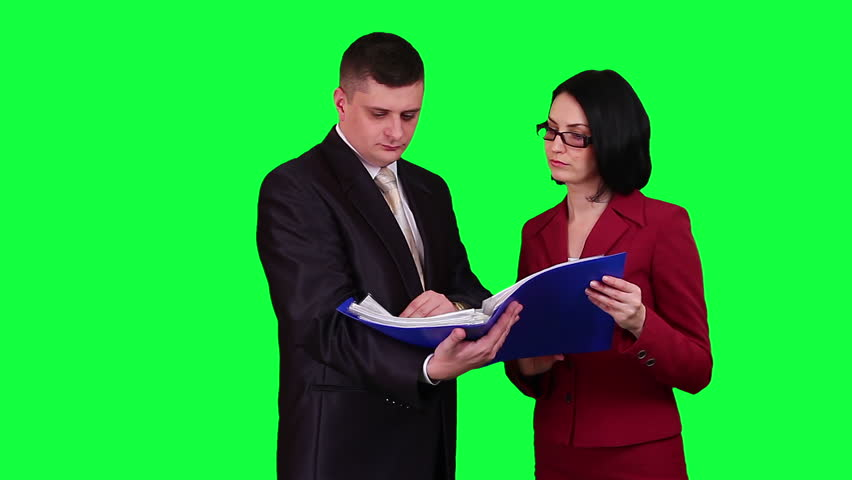 Business people reading documents chroma key