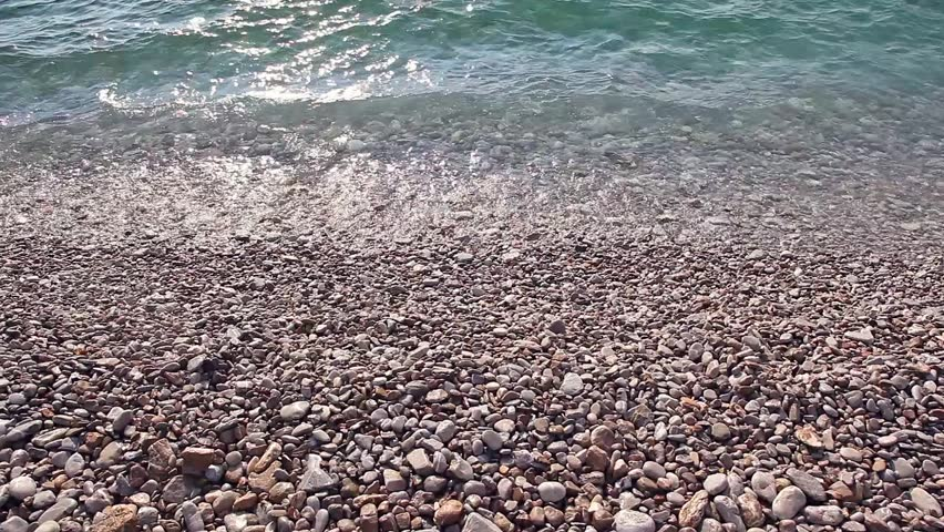 Sea wave incident on the coastal shingle. Montenegro, Europe. Beauty world. HD video (High Definition)