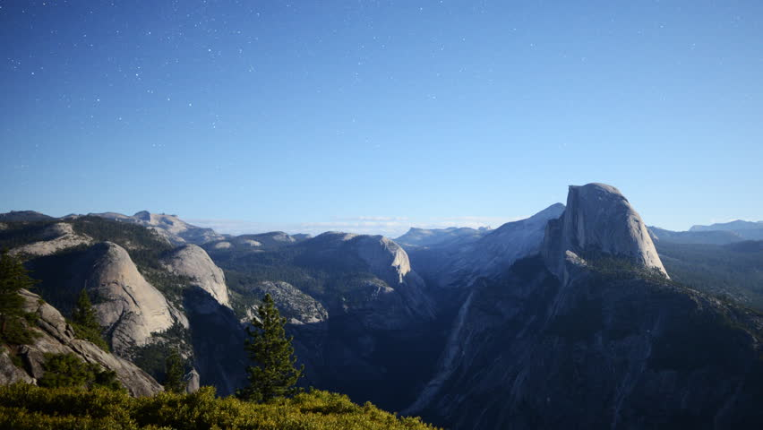 4K Time lapse footage with pan right motion of moon shadow casting across Yosemite Valley in Yosemite National Park, California